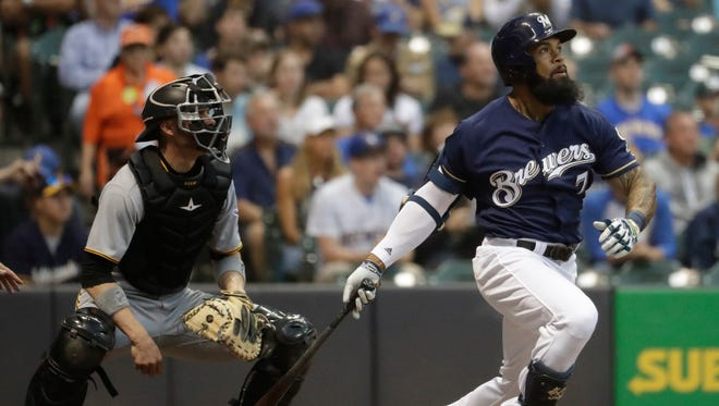 Eric Thames launches a home run to right to give the Brewers an early 1-0 lead in the second inning against the Pirates on Tuesday night at Miller Park.