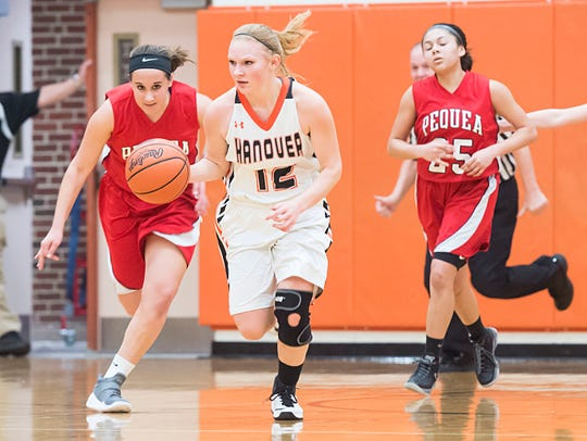 Hanover's Avery Martz drives down the court in the