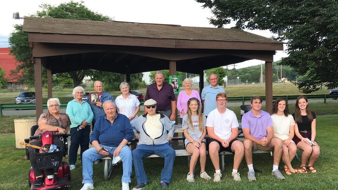 The very generous Hornell High School Class of 1960 were able to present children and grandchildren of the Class of 1960 with scholarships that amounted to a total of $6,500. The presentation took place at James St. Memorial Park in Hornell.In attendance, front row, seated on bench: George Sexsmith and Mike Crowe, along with scholarship recipients Kaitlin Cwynar, Connor O'Rourke, Collin Buisch, Emma Flaitz and Ashley Gillette. Back row: Josie Cartella Brown, Barbara Bishop Clancy, Tony Aini (with picture of Bill O'Rourke), Johanna Oxx Curtis, Dan McManus, Carolyn Kuhn Kelly and Tom Secondo.