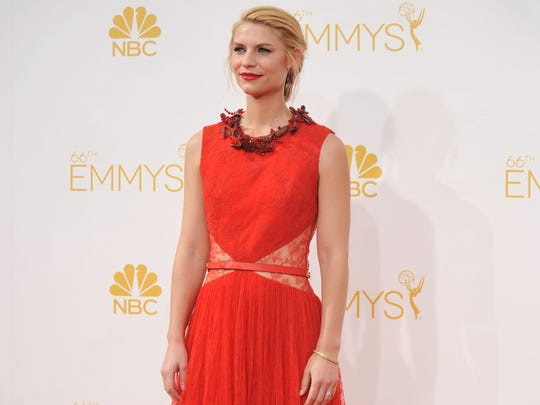 Claire Danes arrives at the 66th Annual Primetime Emmy Awards at the Nokia Theatre L.A. Live on Monday, Aug. 25, 2014, in Los Angeles.