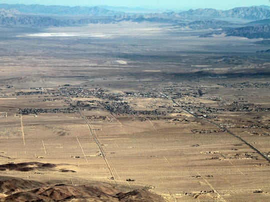 The town of Twentynine Palms is seen in this aerial photograph shot Jan. 31, 2013. On the right is Highway 62, a road where at least 12 Marines have died since 2007.