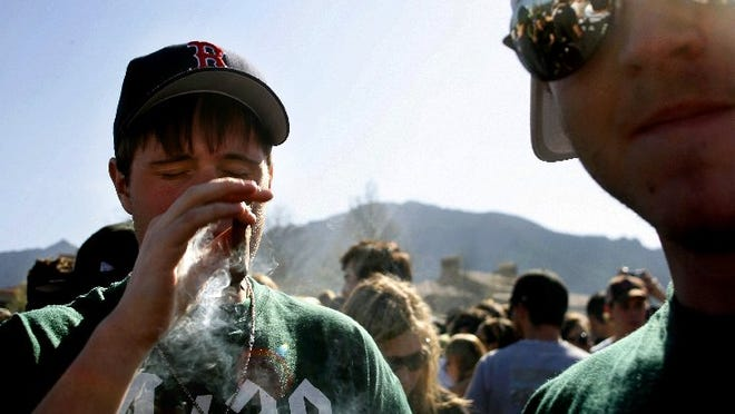An unidentified student smokes marijuana on campus April 20 at the University of Colorado in Boulder in this 2006 file photo.