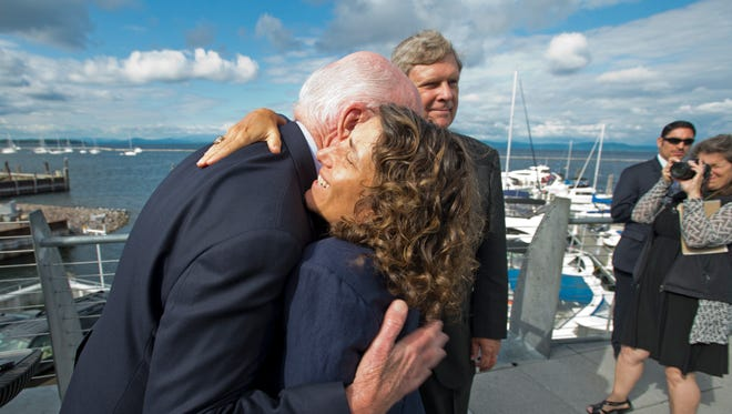 Secretary of the Vermont Agency of Natural Resources Deb Markowitz hugs Sen. Patrick Leahy after U.S. Secretary of Agriculture Tom Vilsack, center, announced $45 million to help with water quality efforts in Lake Champlain during a press conference Thursday morning in Burlington.