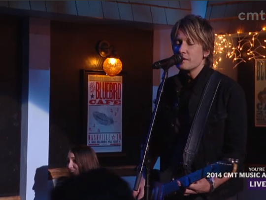 """Keith Urban performed """"Cop Car"""" on what was revealed to be """"Nashville""""'s Bluebird Cafe set during the CMT Awards."""