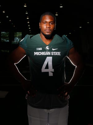 Michigan State defensive lineman Malik McDowell poses for a photo Aug. 8, 2016, in East Lansing.