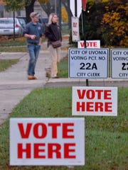 Voters arrive as the polls open at Kennedy Elementary in Livonia.