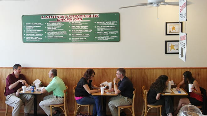 Visitors to Larry's Lunchbox dine at the Naples location on Thursday.