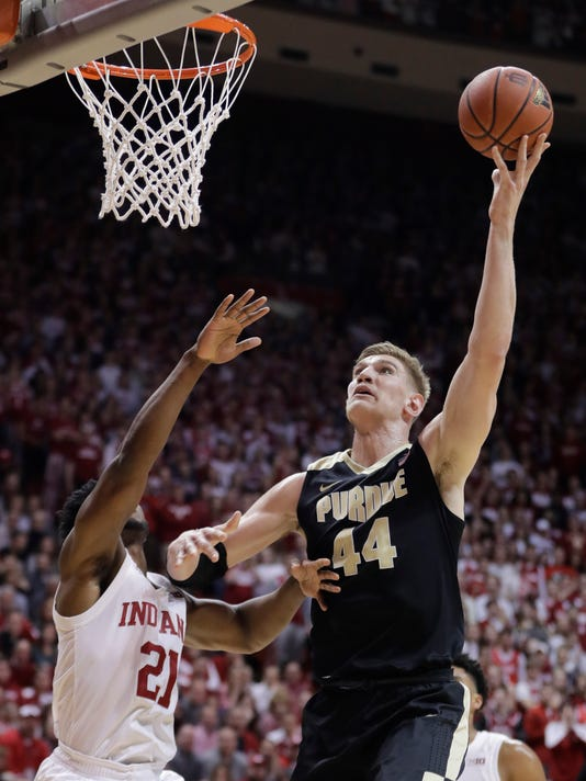 Purdue's Isaac Haas (44) shoots over Indiana's Freddie McSwain Jr. during the first half of an NCAA college basketball game, Sunday, Jan. 28, 2018, in Bloomington, Ind. (AP Photo/Darron Cummings)