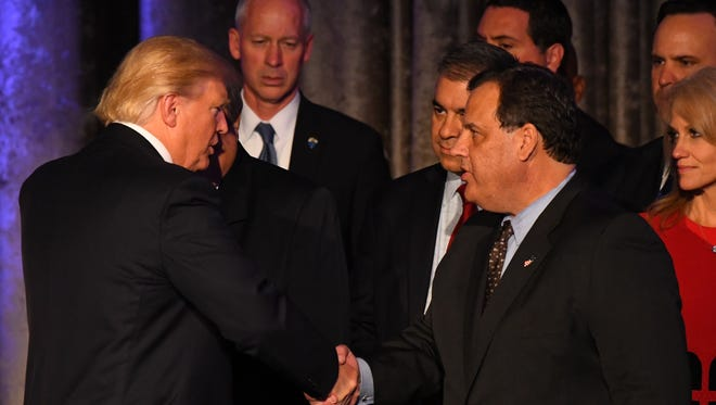 President-elect Donald Trump greets Chris Christie after speaking to supporters at New York Hilton Midtown on election night.