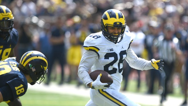 University of Michigan player Brandon Watson runs for the end zone.