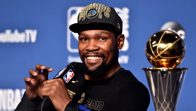 Golden State Warriors forward Kevin Durant speaks, after defeating the Cleveland Cavaliers in Game 4 to win the NBA finals at Quicken Loans Arena on June 8, 2018 in Cleveland.
