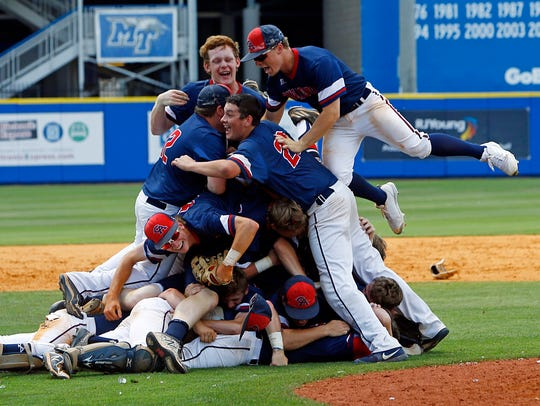 Columbia Academy players celebrate after defeating