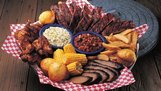 Famous Dave's all-American BBQ feast includes St. Louis ribs, chicken, Texas brisket or Georgia chopped pork, coleslaw, fries, beans, corn and cornbread.
