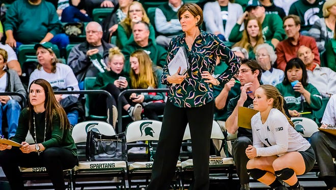 MSU Volleyball Head Coach Cathy George ,center, watches her team dismantle Fairfield in the 3rd set.