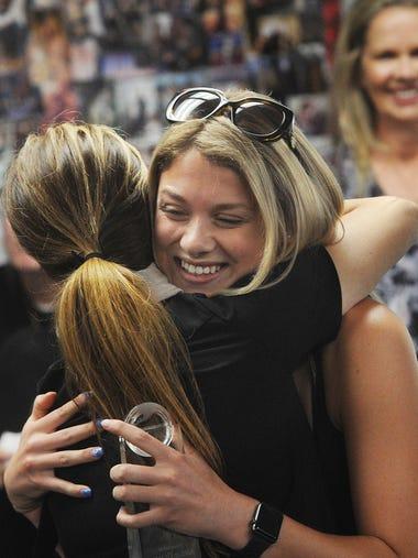 Ashlie Glantz, a Simi Valley High senior, is hugged
