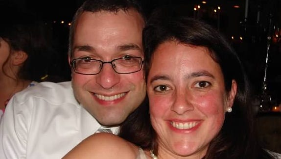 A 2012 photo of Dr. Amy Reed, whose hysterectomy procedure last year spread a previously undetected cancer by morcellation, with her husband Dr. Hooman Noorchashm.