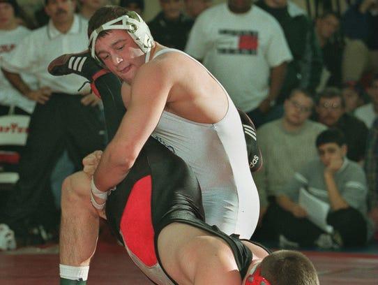Lakewood's Matt Damion Hahn looks to turn Lenape's Brett Sanderlin during their 189-pound bout.