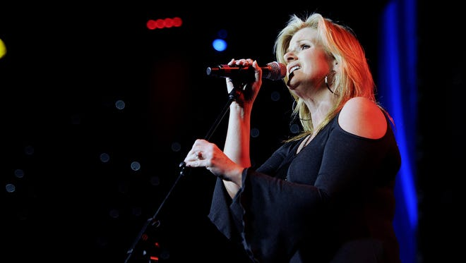 """Trisha Yearwood is performing """"On a Bus to St. Cloud."""" The song was written by Gretchen Peters, who is being inducted into the Nashville Songwriters Hall of Fame at the Music City Center Oct. 5, 2014."""