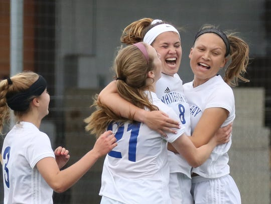 Whitefish Bay's Ali Menard celebrate her goal with