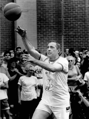 From the archive: New York Gov. Mario Cuomo takes a shot during the Jumpin' Jack Shootout on July 20, 1990.