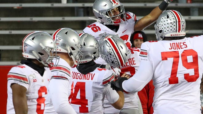 Ohio State wide receiver Jaelen Gill (26) celebrates his touchdown reception during the fourth quarter of an NCAA college football game against Rutgers on Saturday, Nov. 16, 2019 in Piscataway, N.J. Ohio State won 56-21. (Andrew Mills/NJ Advance Media via AP)