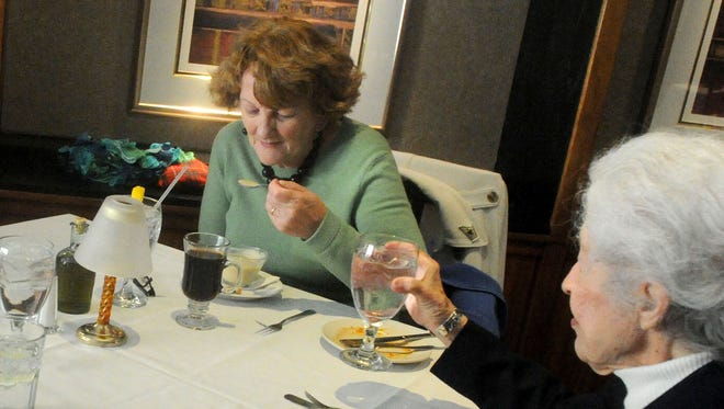 Kay McDonagh (left) and Kitty Wood of Staunton eat lunch. They eat lunch with friends Dick Dickerson and Chuck Jones at Emilio's in downtown Staunton on Sunday, March 3, 2013.