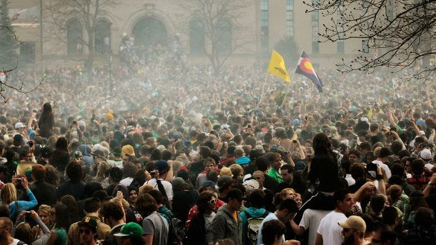 The haze of marijuana smoke looms over a crowd of thousands at 4:20 p.m., April 20, 2010, at the University of Colorado in Boulder.