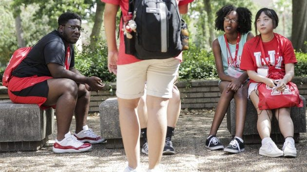 University of Houston incoming students listen to their guide while touring the campus as part of an orientation in Houston, June 13, 2017. International applications to public universities in Texas have dropped by at least 10,000 over the past year, and some school officials cite President Donald Trump as a cause.
