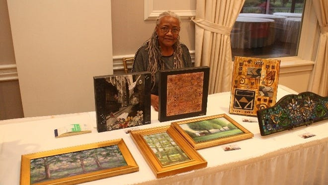 Artist Doris Botts of Vineland displays her paintings and other works of art at Inspira Auxiliary Cumberland County's second annual Art Etc. Sale.