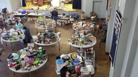 The Kiwanis Club of Columbia sells yard sale items Saturday as part of a fundraiser for Dolly Parton's Imagination Library in Maury County.