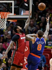 New York Knicks' Michael Beasley (8) shoots as Miami Heat's James Johnson defends during the second half of an NBA basketball game, Friday, Jan. 5, 2018, in Miami. (AP Photo/Lynne Sladky)