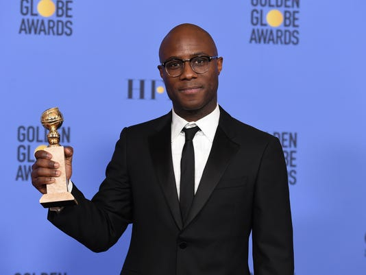 ccd34058a4253 Barry Jenkins poses in press room with the award for Best Motion Picture -  Drama for