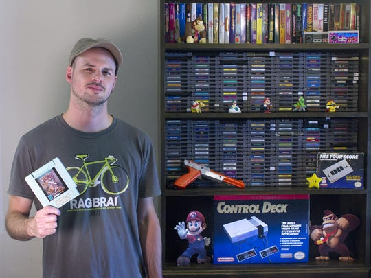 Scott Ephraim is riding in search of old game cartridges for the Nintendo system he grew up with in Cedar Falls.