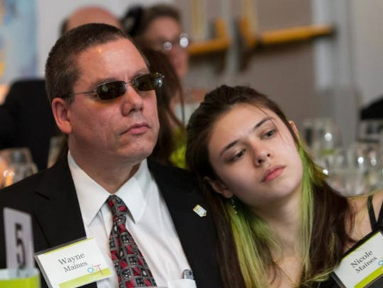 Wayne Maines and his daughter, Nicole, are shown at