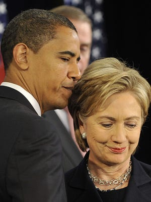 Barack Obama and his former rival Hillary Clinton in 2008.