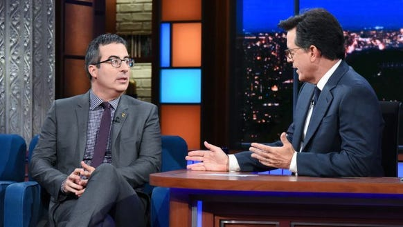 John Oliver, left, makes an appearance on 'The Late