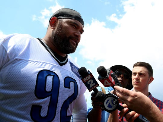 New Lions defensive lineman Haloti Ngata answers questions from the media after the team finished their organized training activities at their practice facility in Allen Park on May 27.