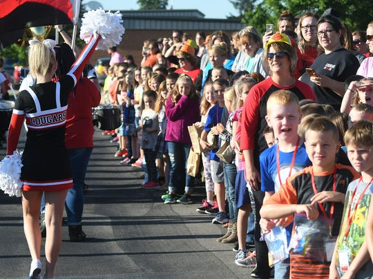 Students from Crestview Schools enjoy a parade celebrating the first day of school Wednesday morning.