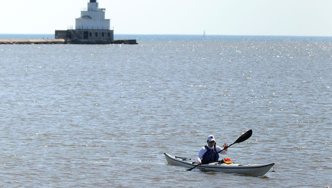 Members of the North East Wisconsin Paddlers group take part in a kayak outing in 2012 near Manitowoc's Lake Michigan shoreline.