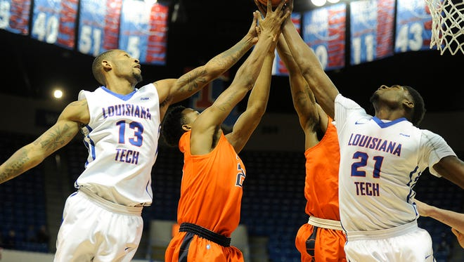 Louisiana Tech's Jacobi Boykins (13) and Merrill Holden (21) go up for a loose ball in Sunday's game against UTEP. Boykins led the Bulldogs with 18 points.