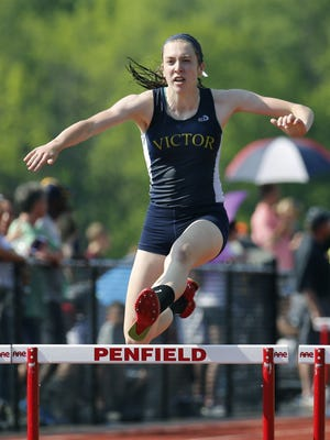 Victor's Erika Tillotson clears the last hurdle of the 400-meter race during the Section V Championships at Penfield High School.