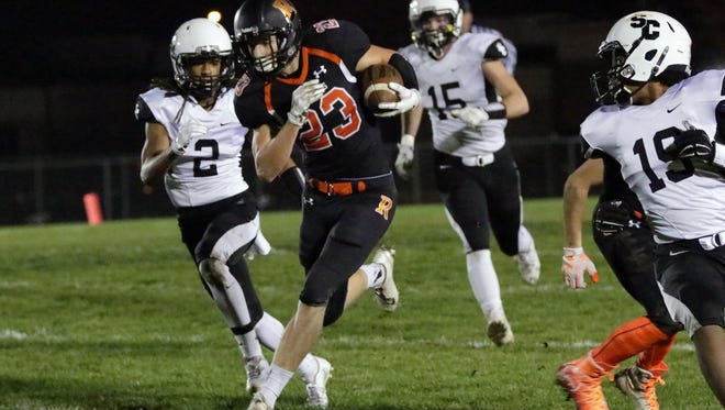 Cedar Grove-Belgium's Reid Hilbelink (23) runs with the ball after intercepting a pass during action with Racine St. Catherines Friday October 28, 2016 at Cedar Grove.