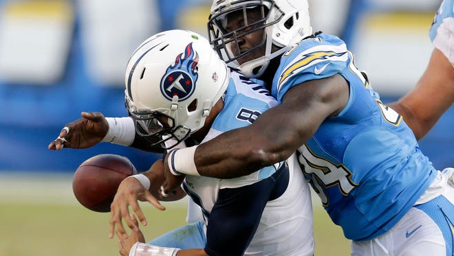Tennessee Titans quarterback Marcus Mariota, left, drops the ball as he is brought down by San Diego Chargers outside linebacker Melvin Ingram on  Nov. 6, 2016, in San Diego. The Chargers recovered the ball and scored a touchdown on the play.