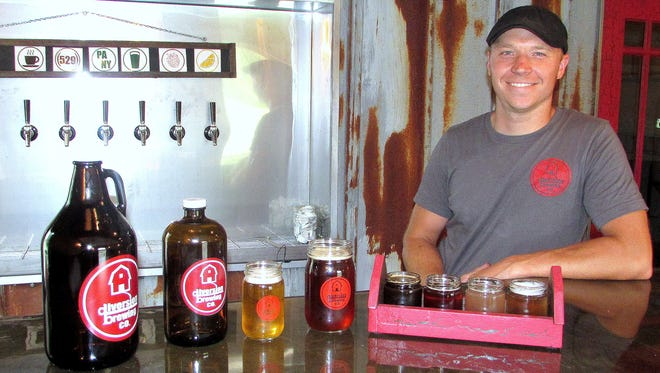 "Dustin ""Dutch"" Blokzyl, co-owner of Diversion Brewing Co. in Chemung, shows off some of the craft beers available to people who follow the Craft Your Adventure Southern Finger Lakes Beverage Trail."