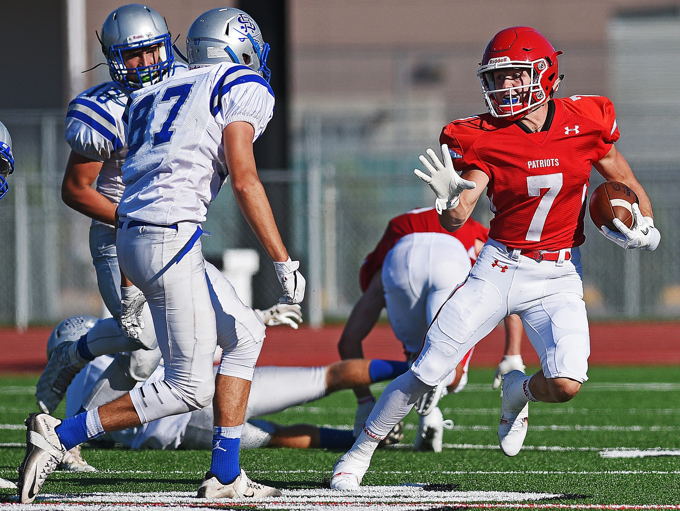 Lincoln's Cole DeBerg (7) rushes with the ball during a game against Rapid City Stevens Saturday, Aug. 27, 2016, at Howard Wood Field in Sioux Falls.