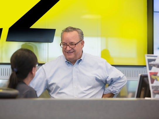 Hertz CEO John Tague visits with a customer service