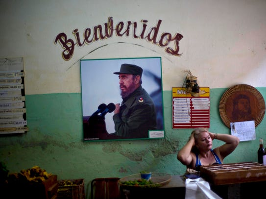 A photograph of Fidel Castro hangs under the Spanish