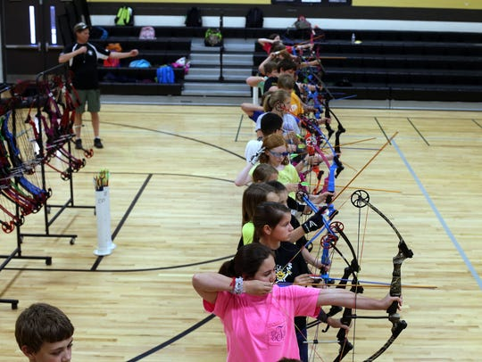 The Archery Club at Christiana Elementary practices
