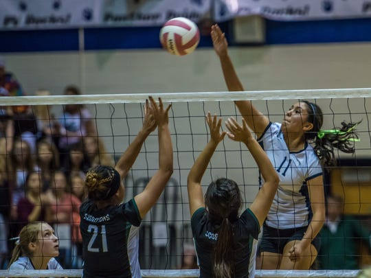 Piedra Vista's Autumn Begay gets a kill against Farmington