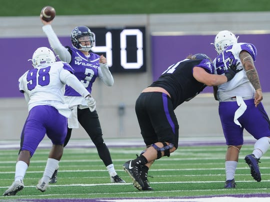 ACU quarterback Luke Anthony (3) throws a pass as Temisan Kuyatsemi (98) applies pressure in the Wildcats' spring game Friday, April 6, 2018 at Wildcat Stadium.